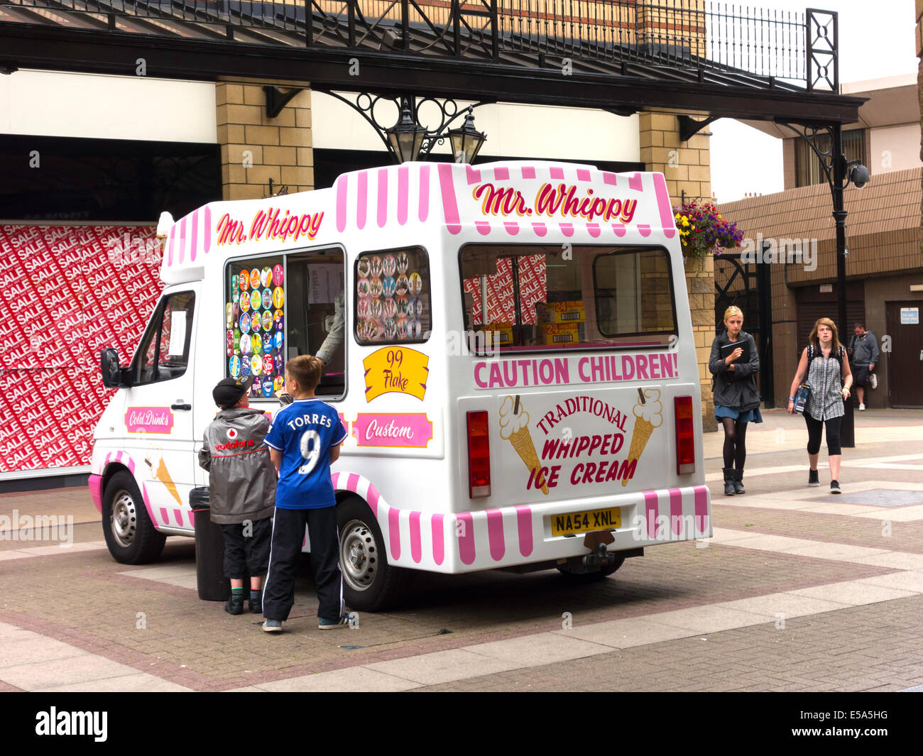 4b7d7467ad Boys buying Ice Cream from a traditional Mr Whippy van in Captain Cook  Square Middlesbrough -