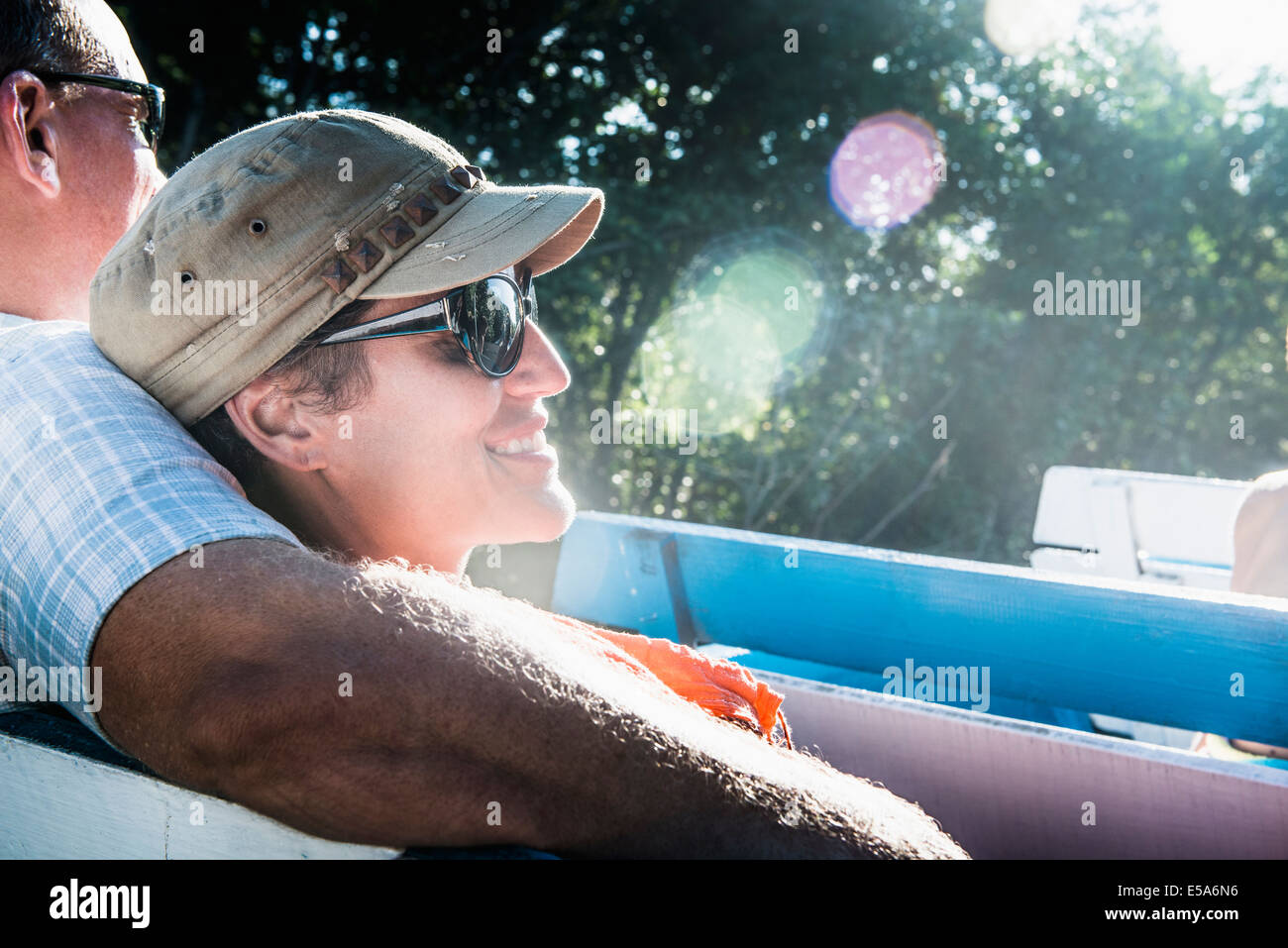 Couple relaxing in boat Stock Photo