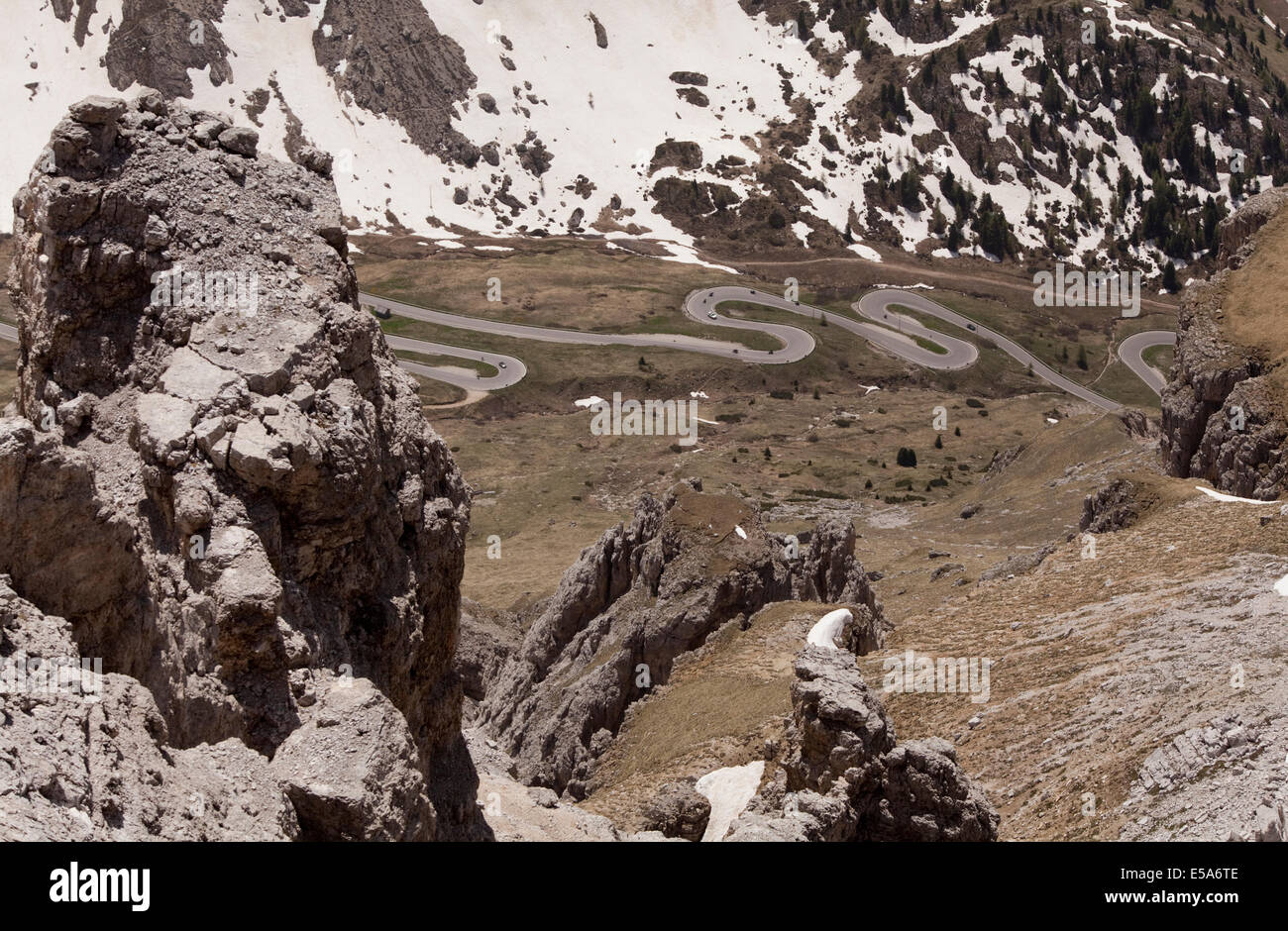 Motorbikes on the famous hairpin bends on the road through the high altitude Pordoi Pass in the Dolomites, Italy - Stock Image