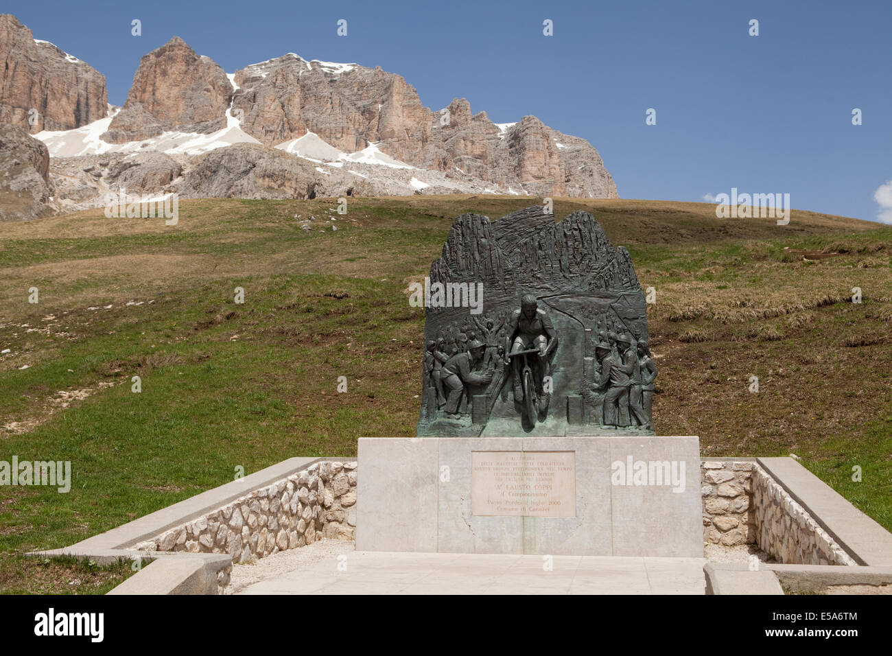 The monument to cyclist Fausto Coppi at the summit of the Pordoi Pass in the Italian Dolomites - Stock Image
