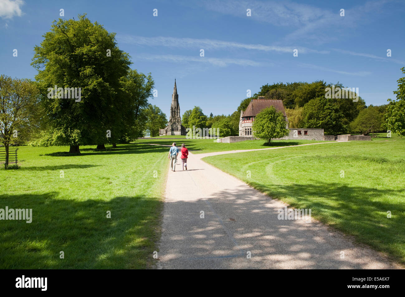 A man and a woman walk through Studley Royal Park in North Yorkshire - Stock Image
