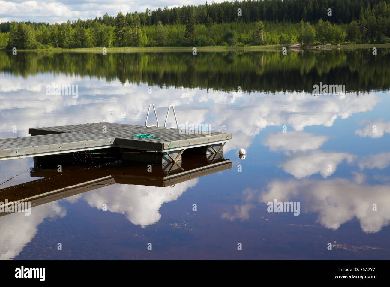 Lake scenery with a pier in summer in Finland - Stock Image