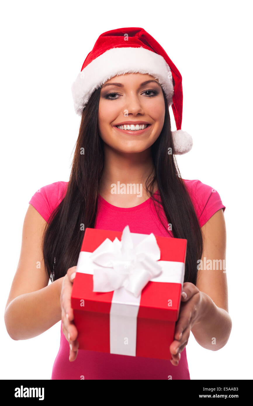 Cute woman with Santa hat giving Christmas gift, Debica, Poland - Stock Image