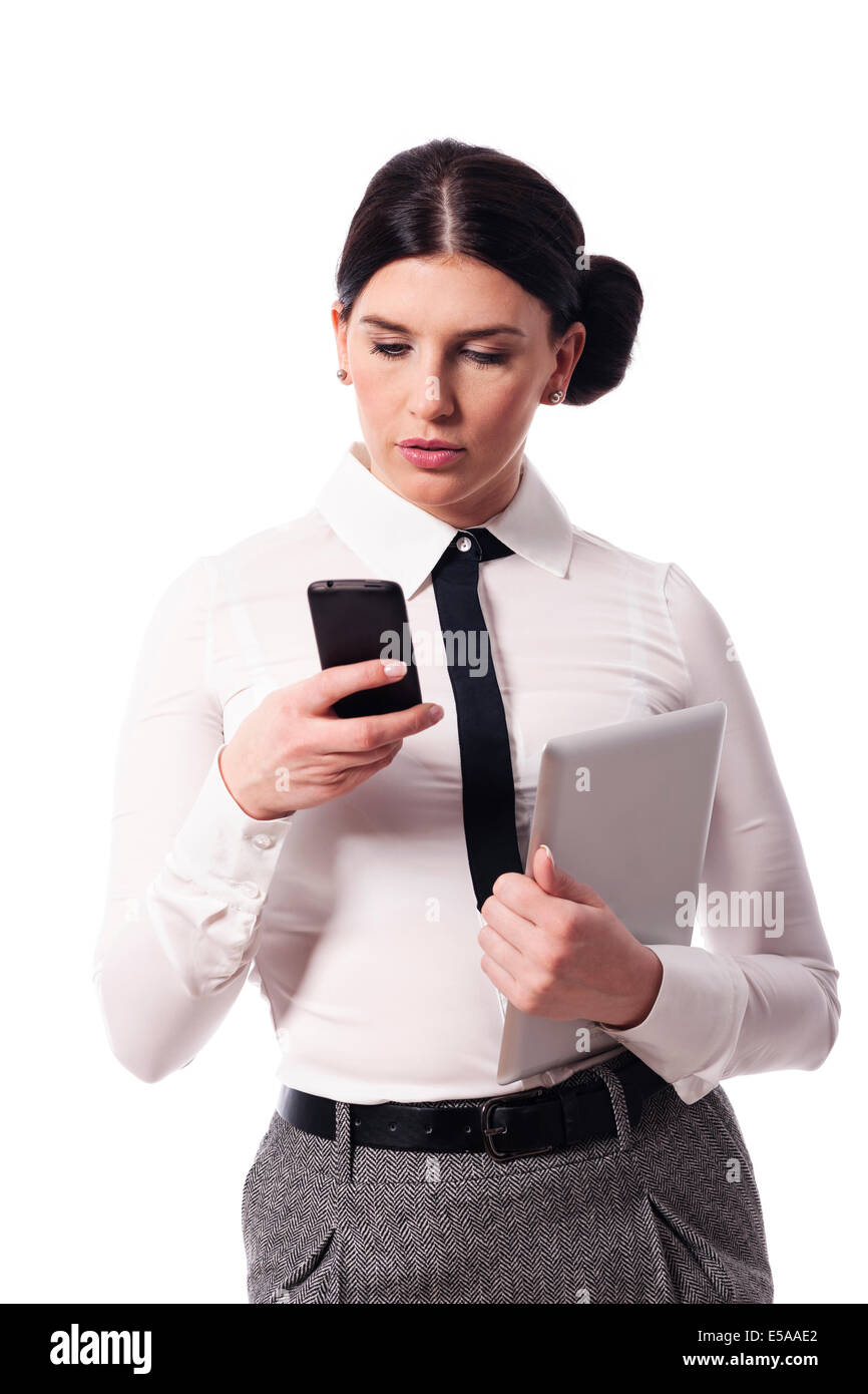 Businesswoman with a phone and digital tablet, Debica, Poland - Stock Image
