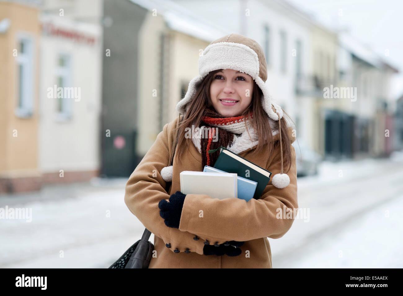 Student girl, wintertime. Debica, Poland. - Stock Image