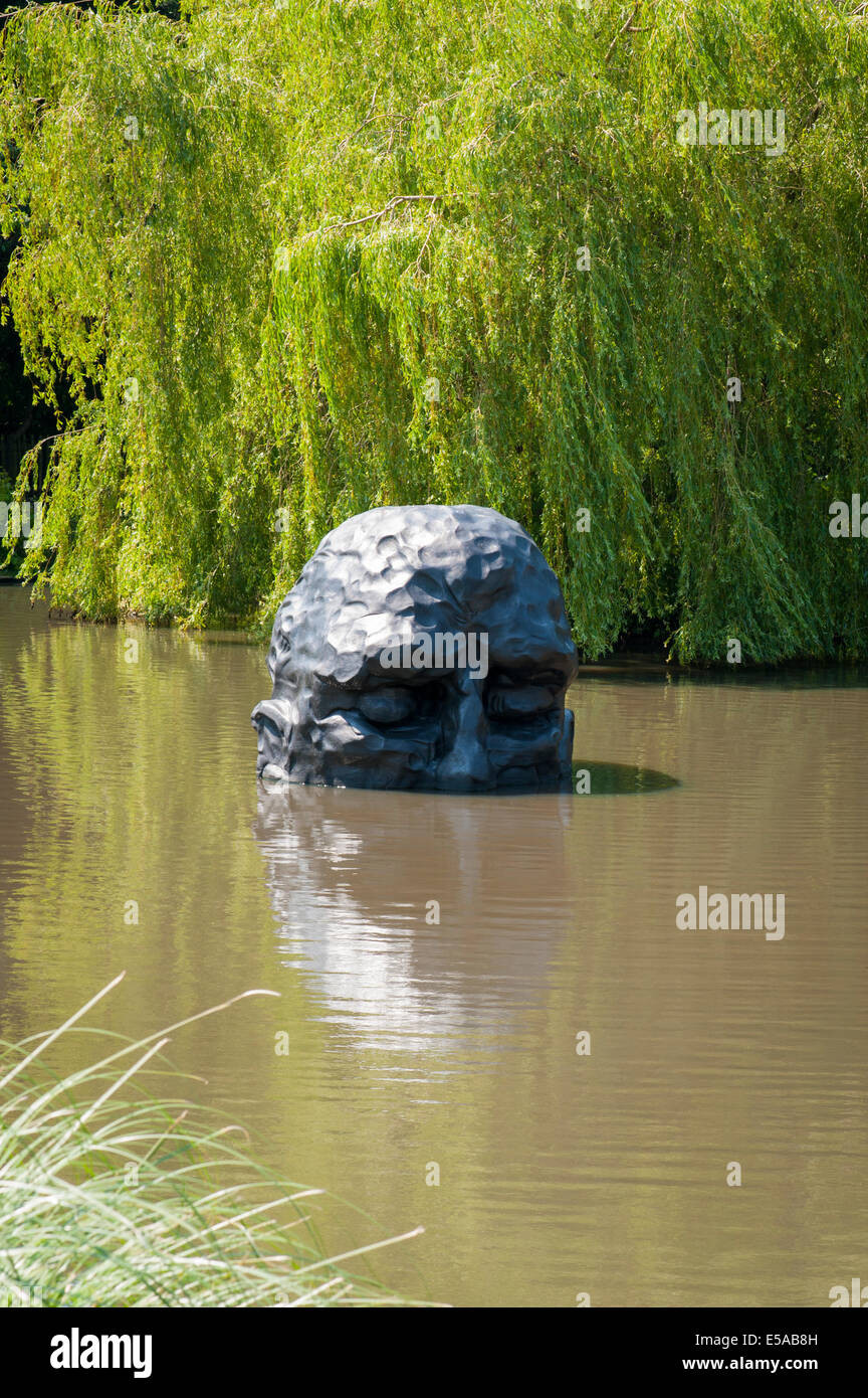 North West London, Golders Hill Park, bronze statue sculpture bust head , The Visitor , by David Breuer-Weil , artist - Stock Image