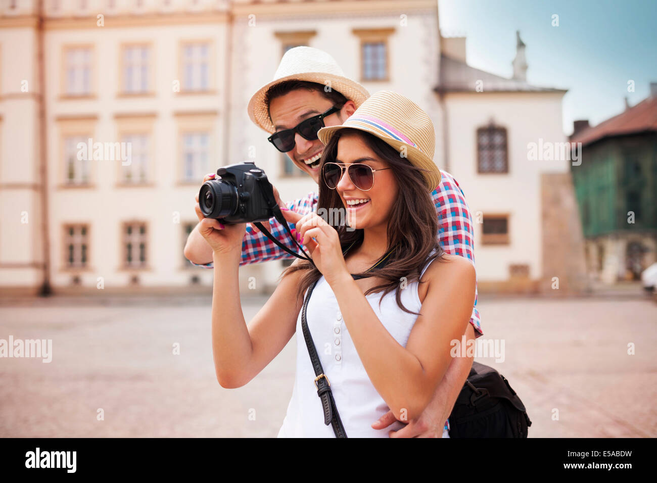 Cute couple looking on their photos on camera, Debica, Poland - Stock Image