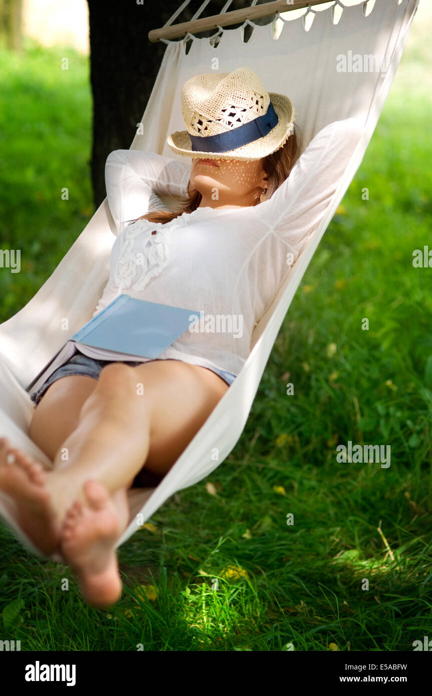 Young woman sleeping on hammock, Debica, Poland. Stock Photo