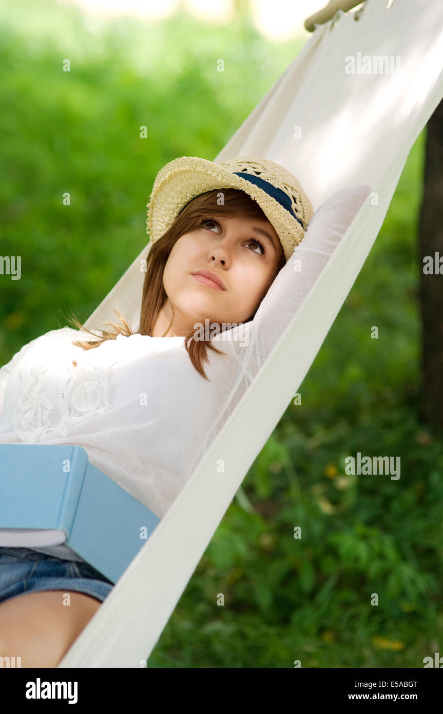 Young woman relaxing on hammock, Debica, Poland. - Stock Image