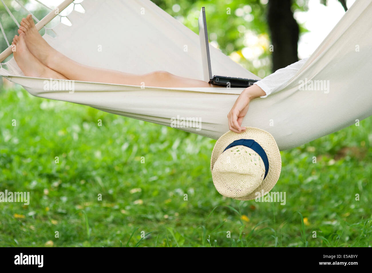 Young woman relaxing on hammock, Debica, Poland. Stock Photo