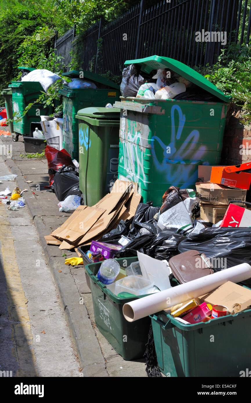 Overflowing rubbish and recycling bins, UK Stock Photo