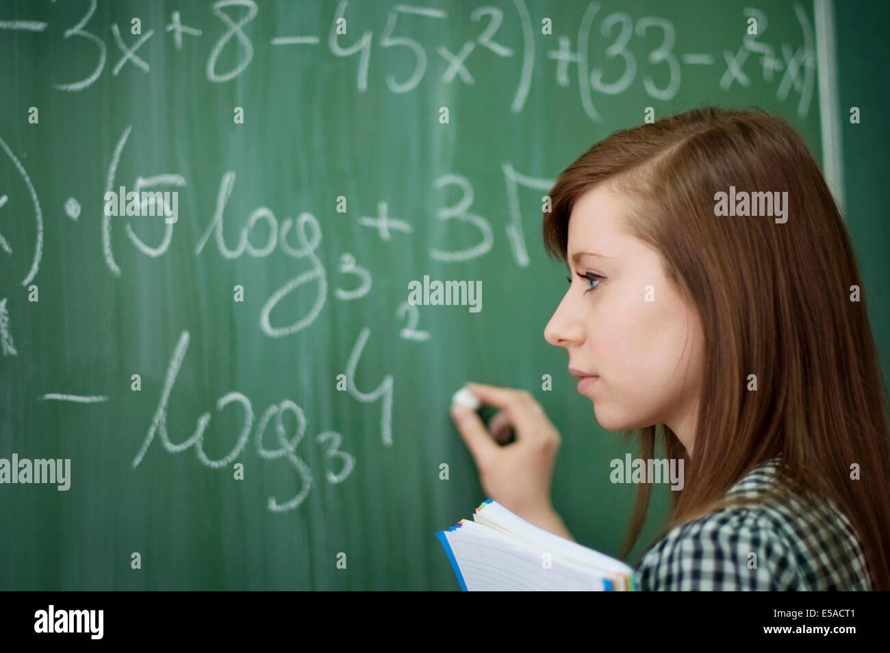 Student girl writing mathematical formula, Debica, Poland. Stock Photo