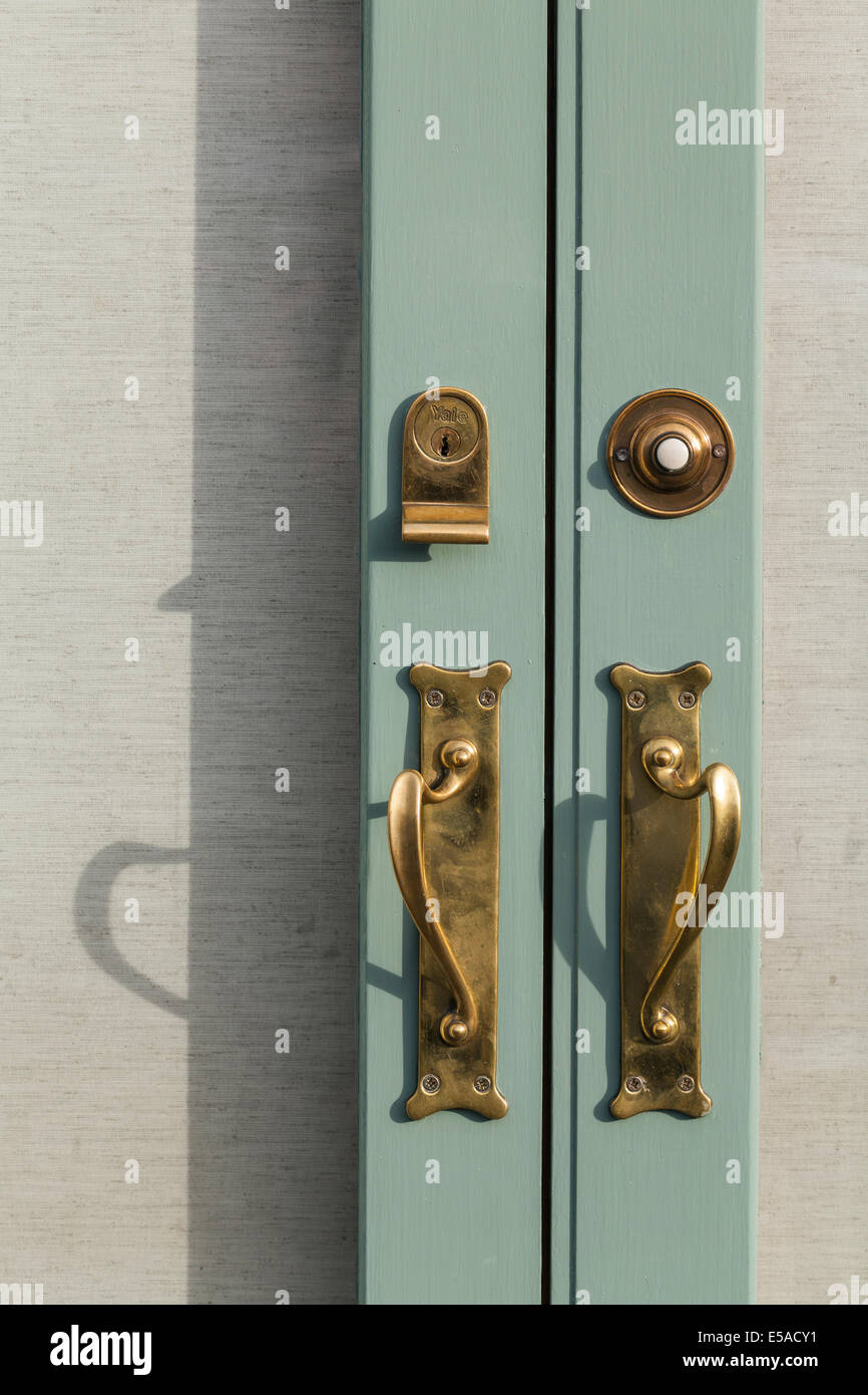 Delicieux Close Up Detail Of Brass Fittings On A Double Door, Handles, Yale Lock And  Bell Push.