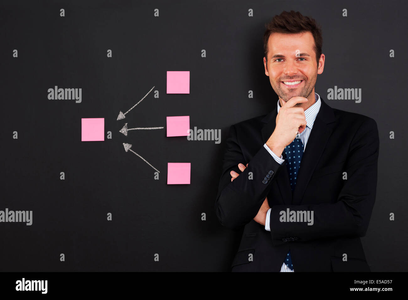 Businessman standing close to diagram from sticky note, Debica, Poland - Stock Image