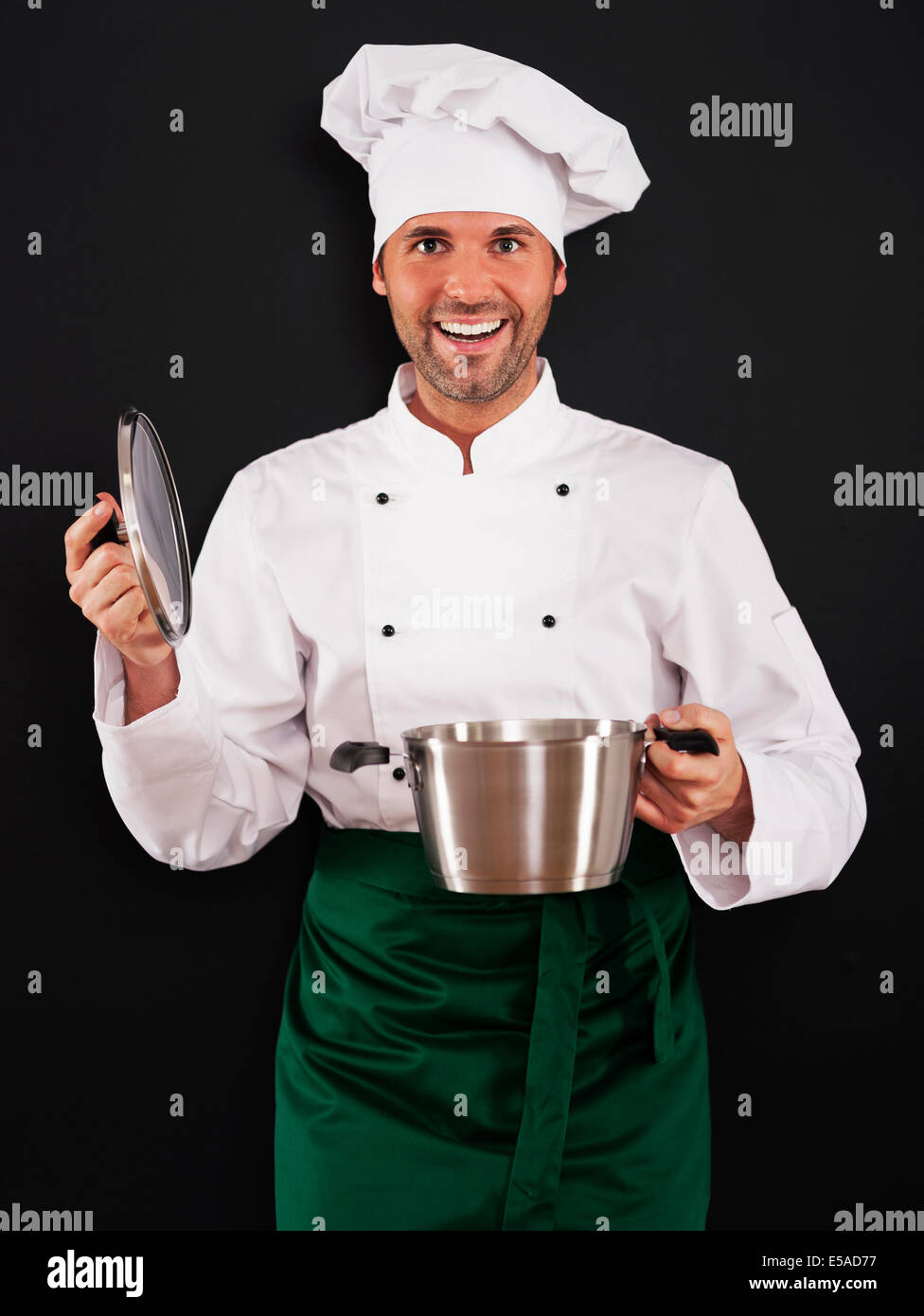 Chef cooking with pot, Debica, Poland - Stock Image