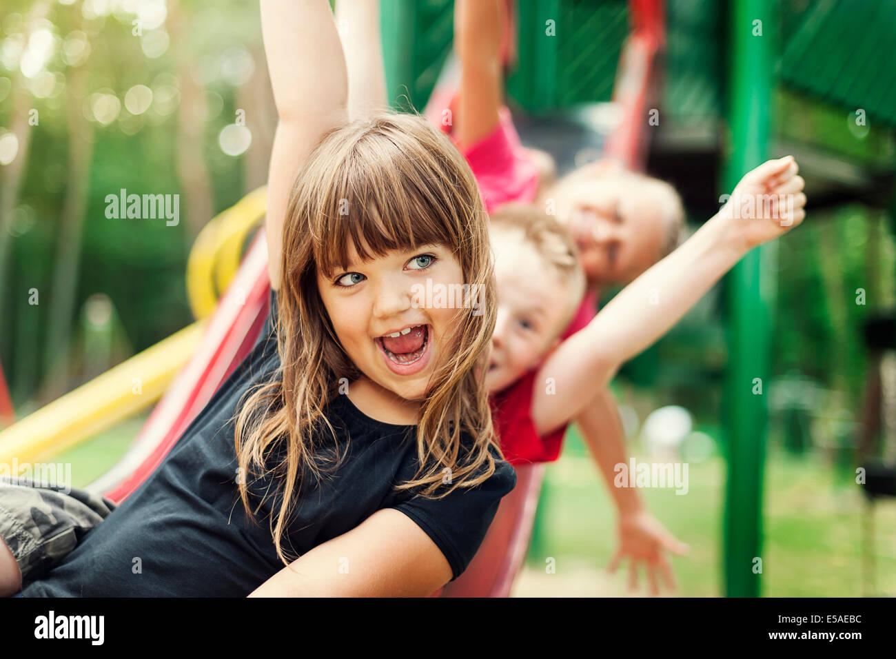 Kids having fun on slide, Debica, Poland - Stock Image