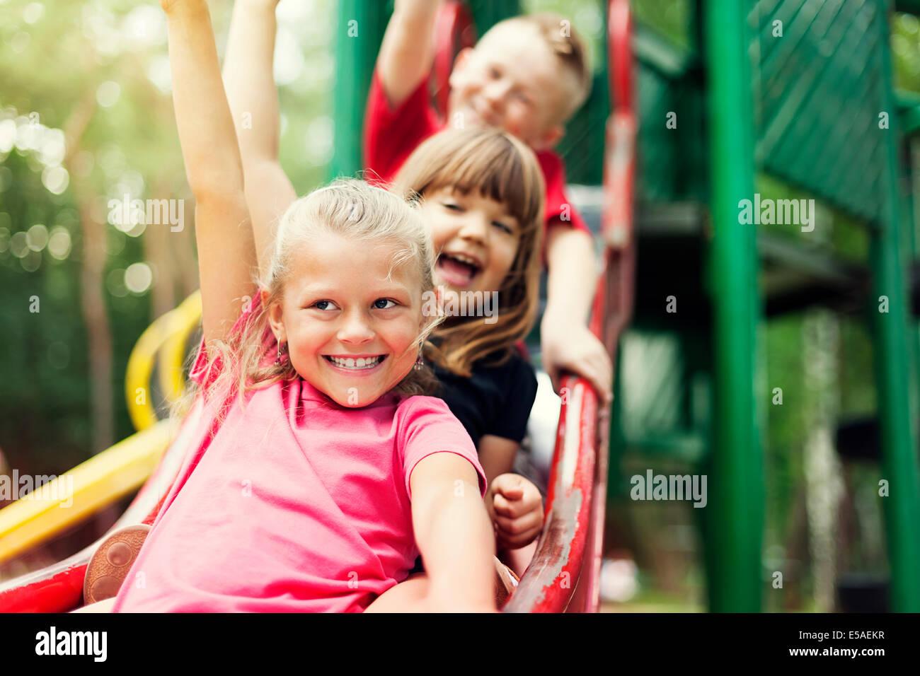 Children on slide, Debica, Poland - Stock Image