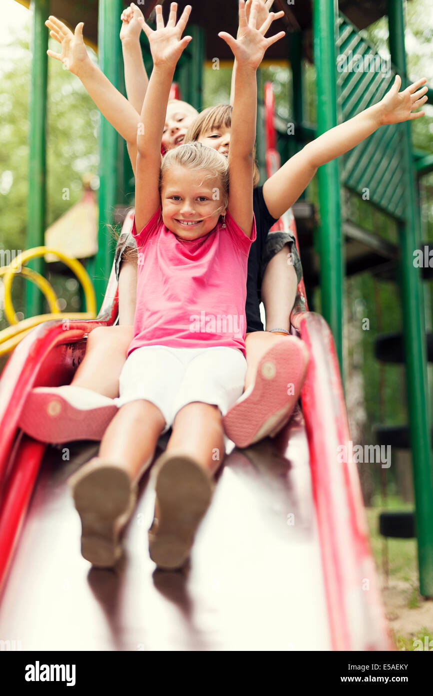 Happy kids slide on playground, Debica, Poland - Stock Image