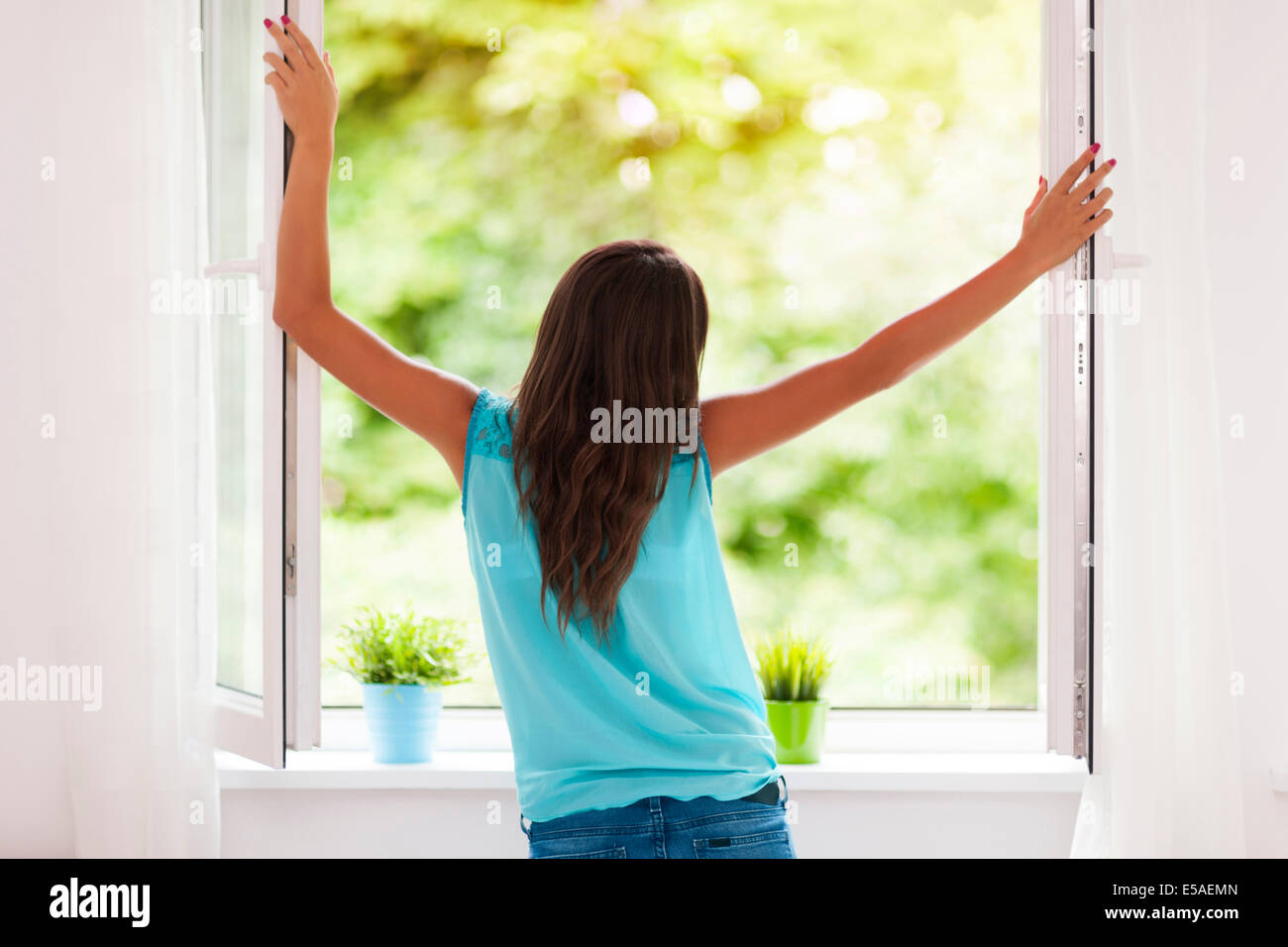 Young woman breathing fresh air during the summer, Debica, Poland - Stock Image