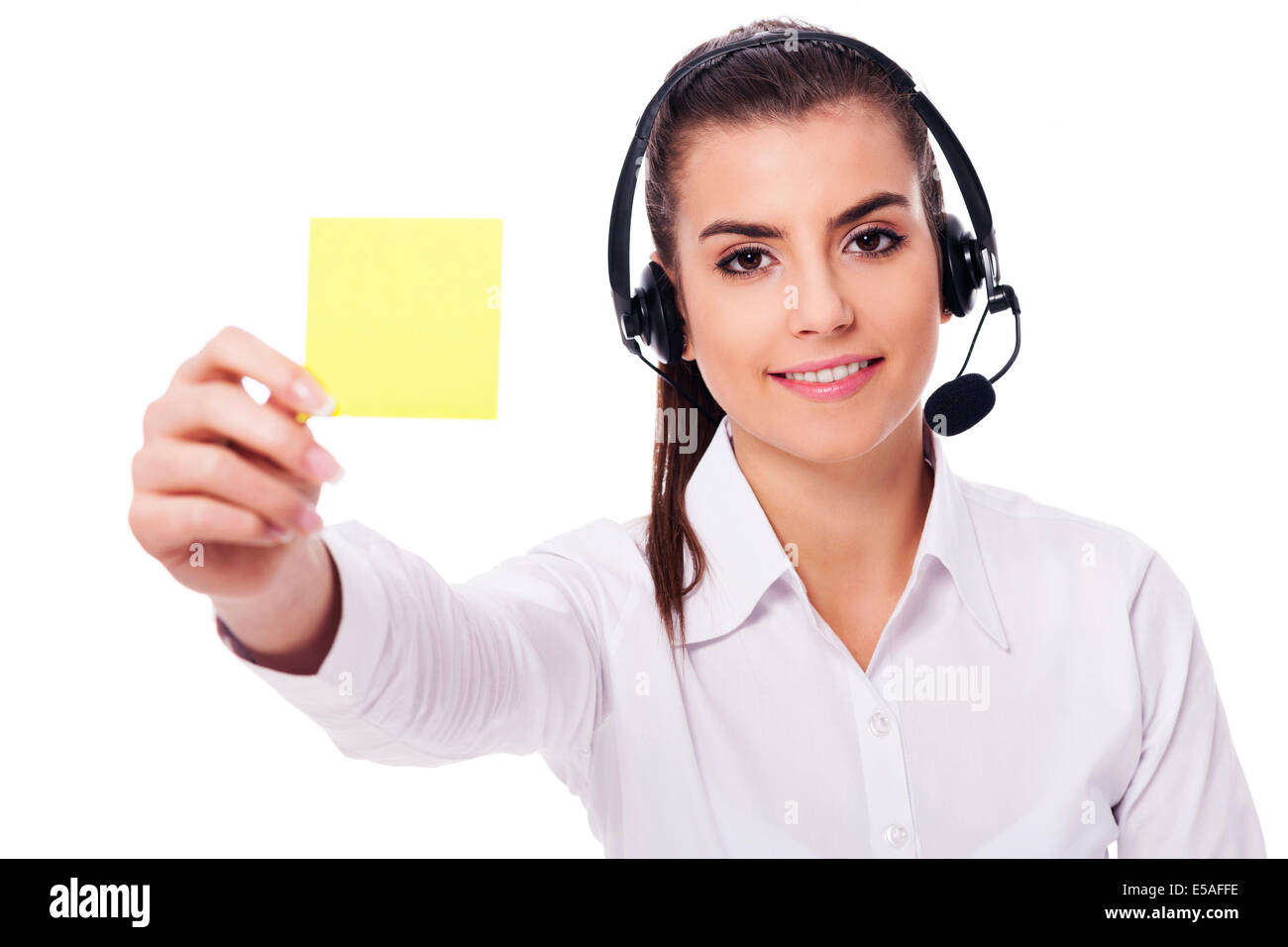 Female operator holding yellow note, Debica, Poland - Stock Image