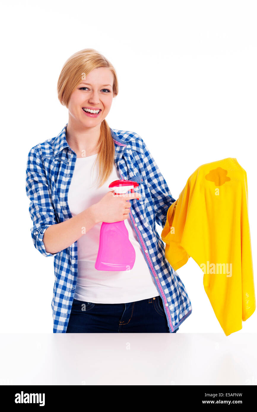 Perfect housewife cleaning the stain with shirts, Debica, Poland - Stock Image