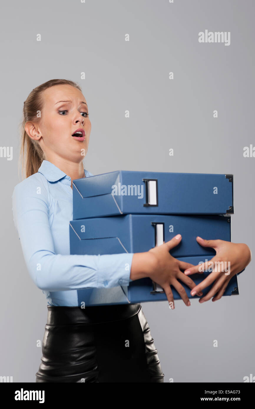 Scared businessman with heavy office documents, Debica, Poland - Stock Image