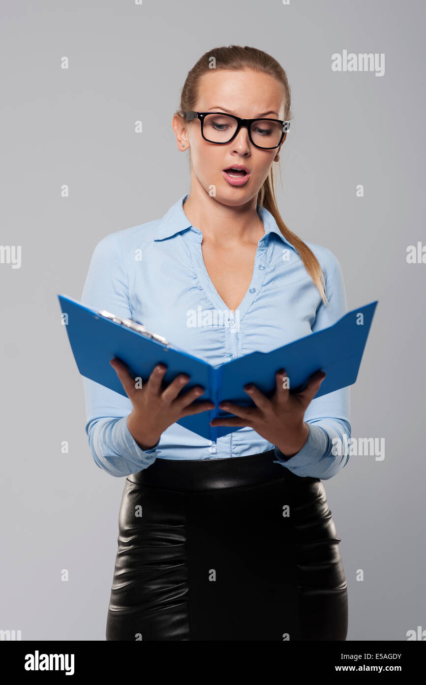 Shocked businesswoman looking at documents, Debica, Poland - Stock Image