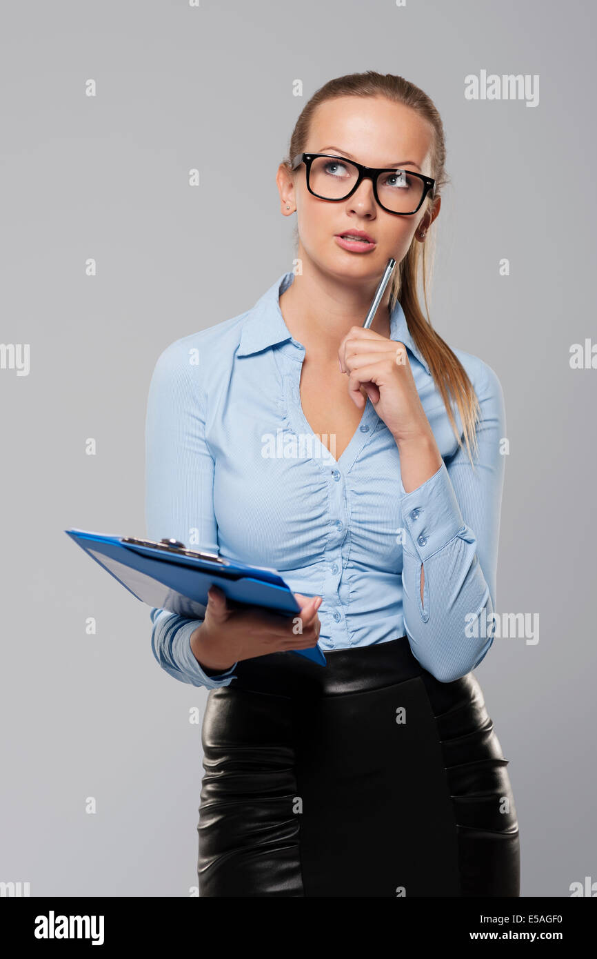 Pensive woman with office documents, Debica, Poland - Stock Image