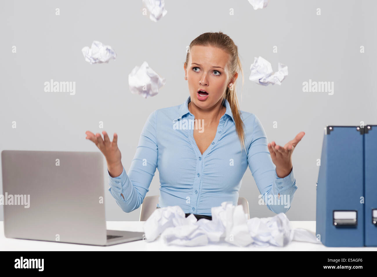 Blonde businesswoman with too many responsibilities, Debica, Poland - Stock Image