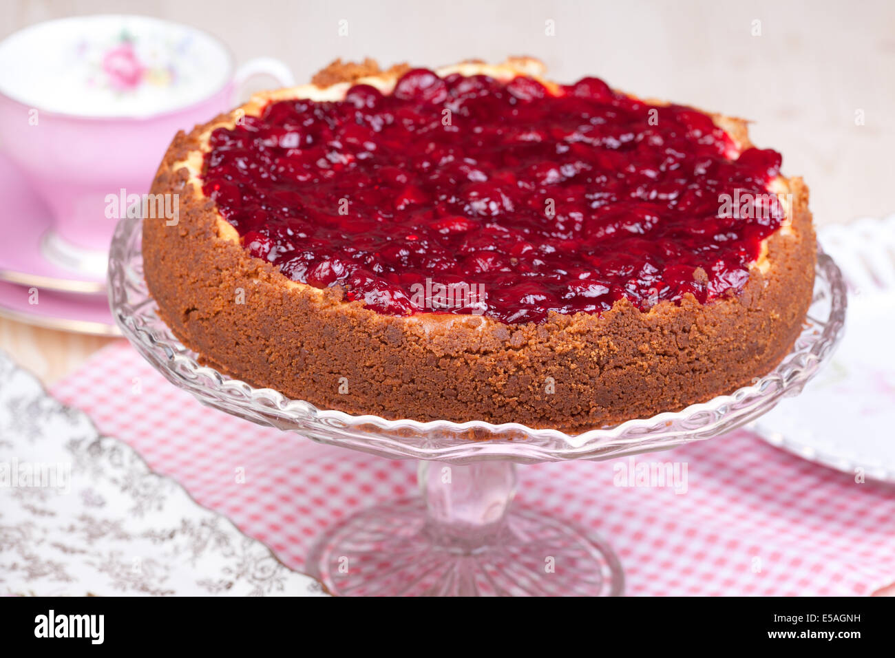 cheesecake with cherries on the table - Stock Image
