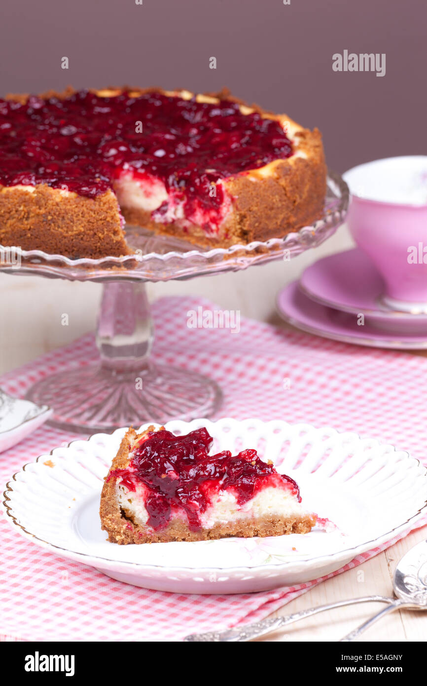 cut piece of cherry cheesecake - Stock Image