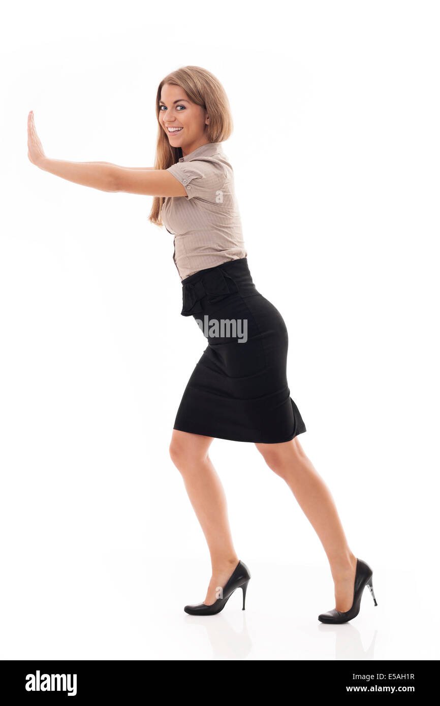 Businesswoman trying to push something, Debica, Poland