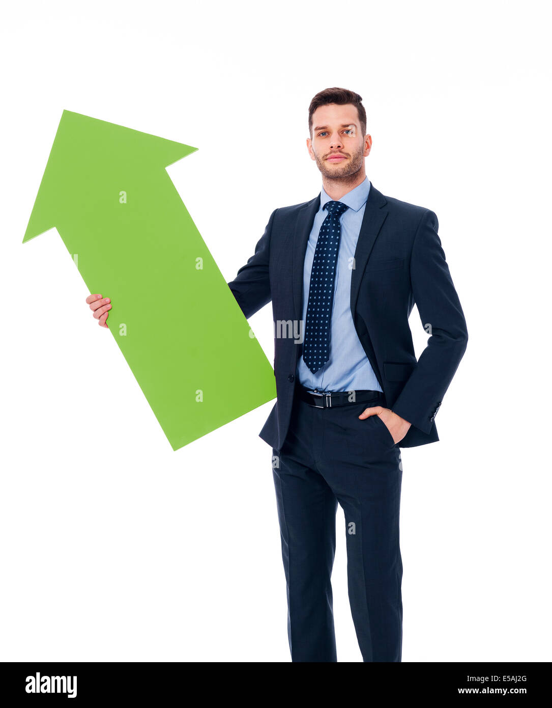 Focus young male holding green sign of arrow, Debica, Poland - Stock Image