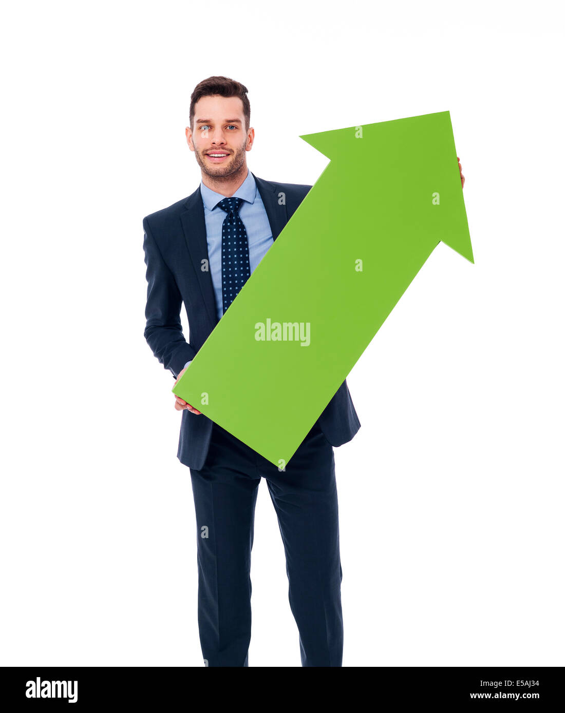 Happy businessman with a green arrow, Debica, Poland - Stock Image