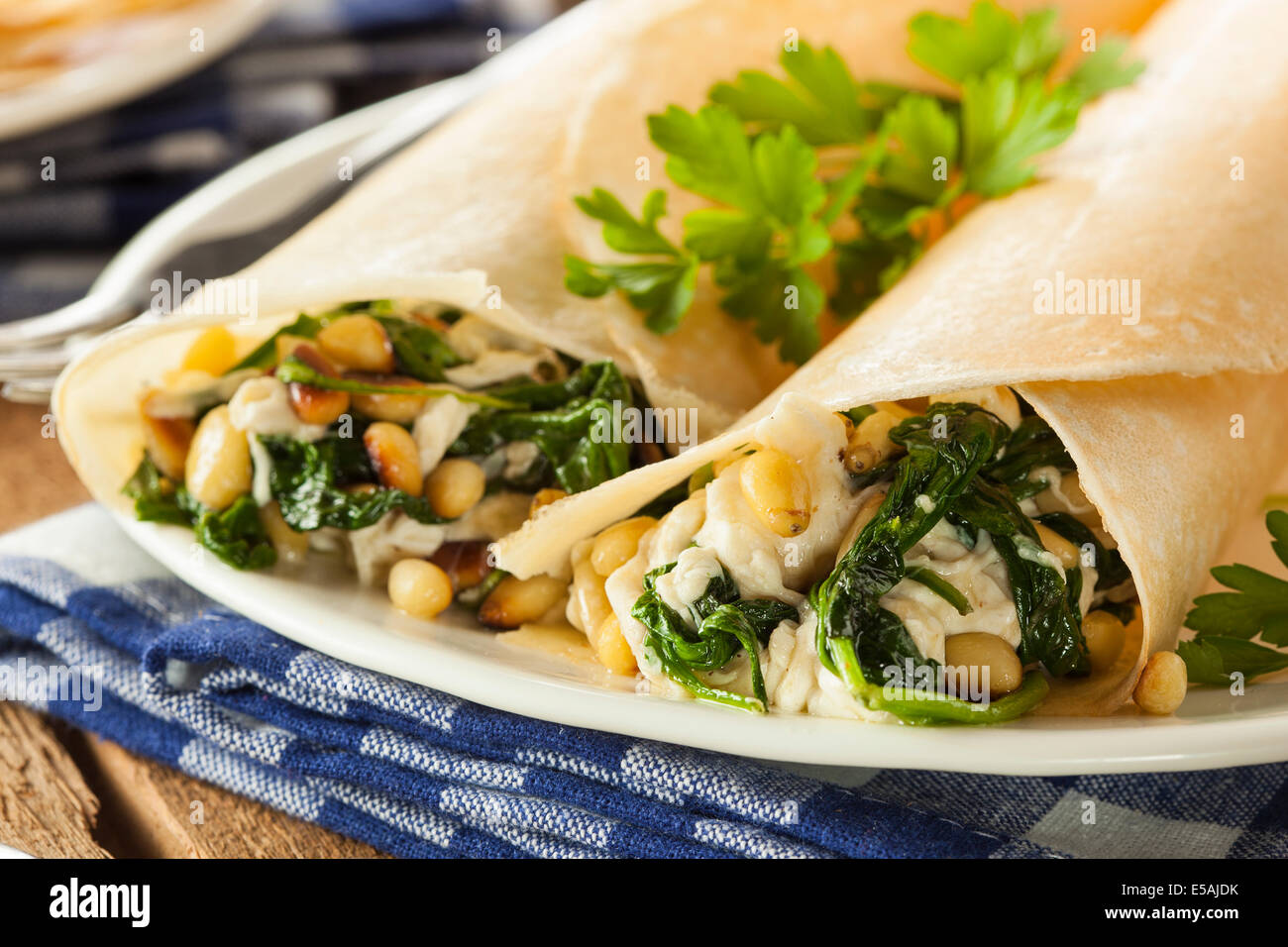 Delicious Homemade Savory French Crepes with Spinach and Feta - Stock Image