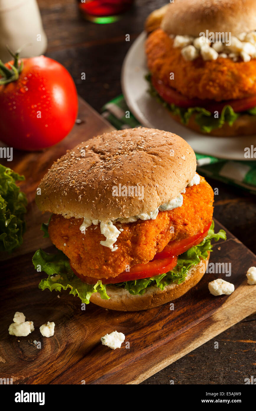 Homemade Buffalo Chicken Sandwich with Hot Sauce and Blue Cheese - Stock Image
