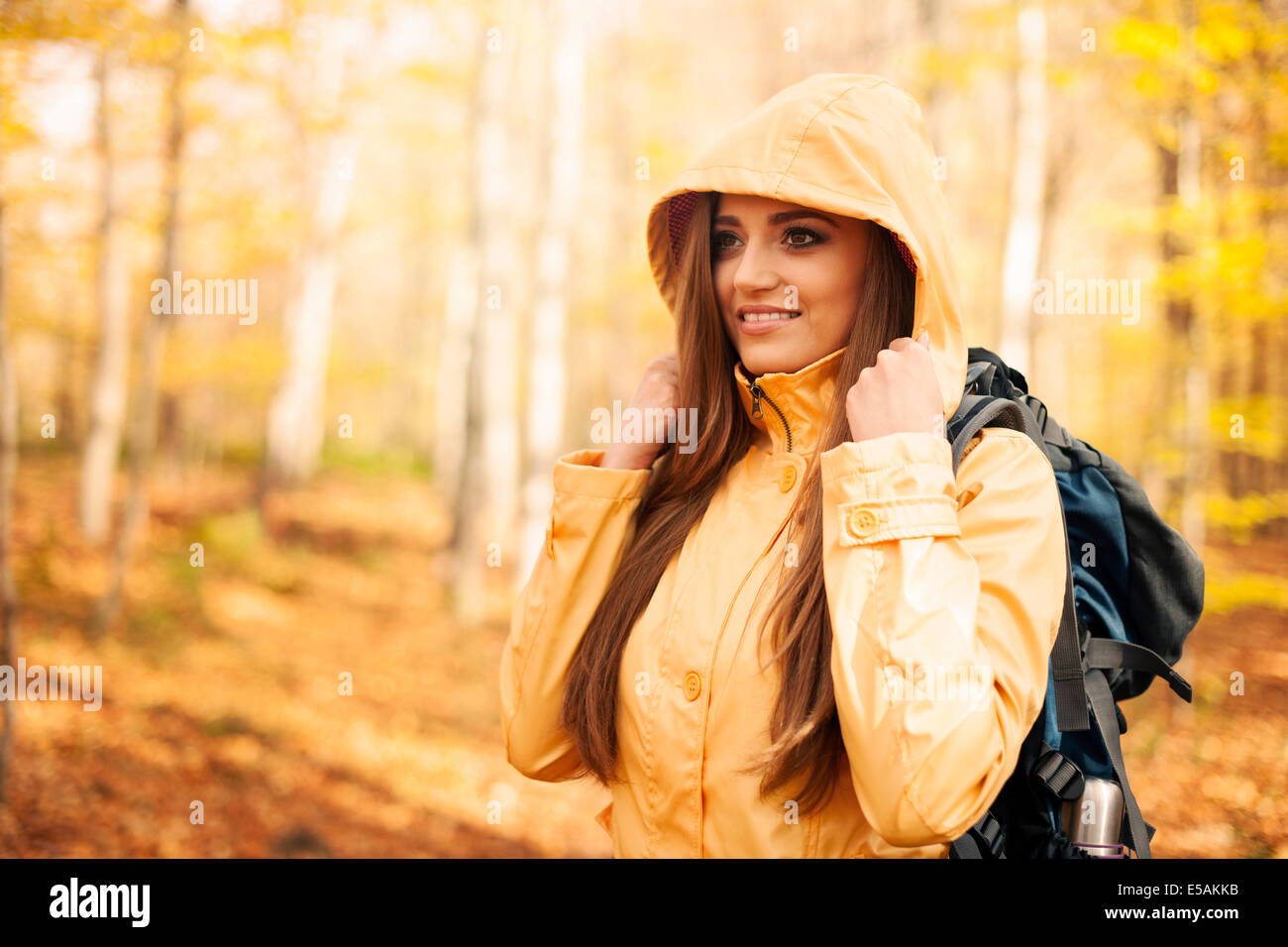 Female hiker protecting against rain, Debica, Poland - Stock Image