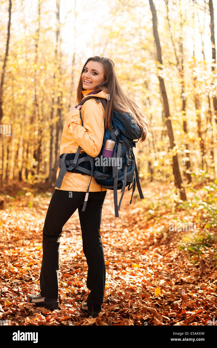 Portrait of beautiful and smiling hiker with backpack, Debica, Poland - Stock Image