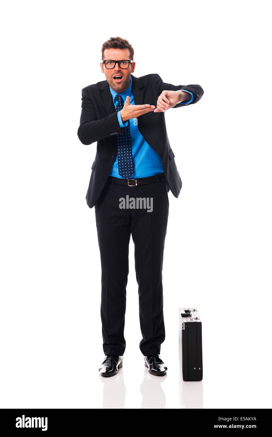 Angry businessman waiting for late business partner Debica, Poland - Stock Image