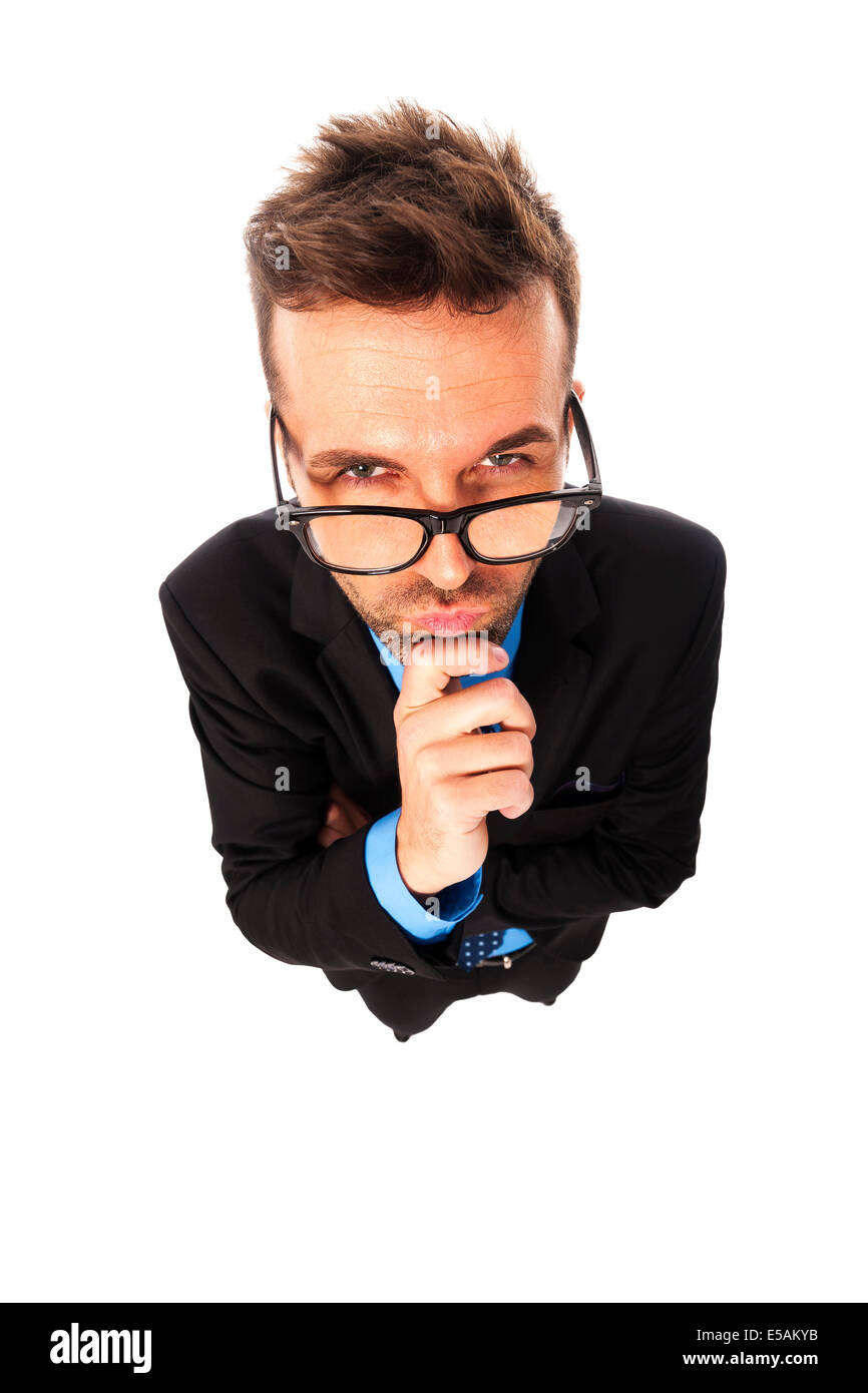 Angry businessman wearing fashion glasses grimacing Debica, Poland - Stock Image