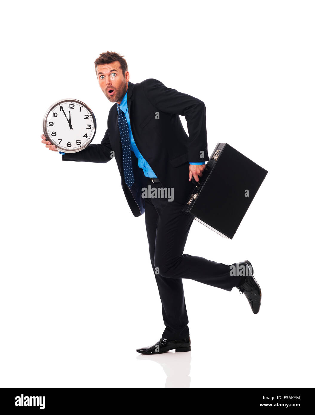 Businessman running late for a meeting Debica, Poland - Stock Image