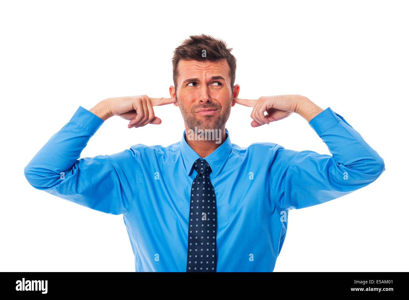 Disgust business man with fingers in ears, Debica, Poland - Stock Image