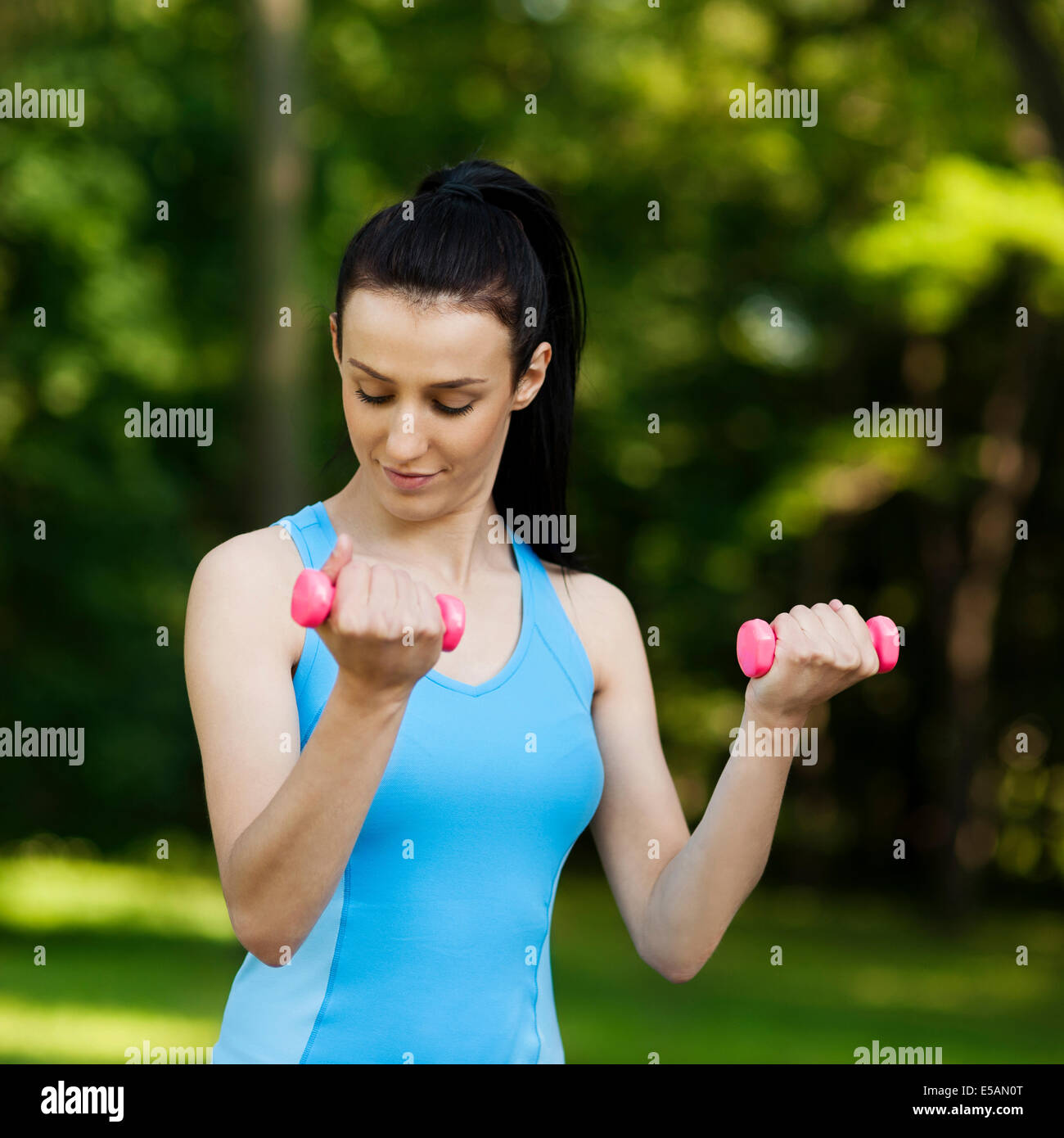 Young woman with dumbbells Debica, Poland - Stock Image