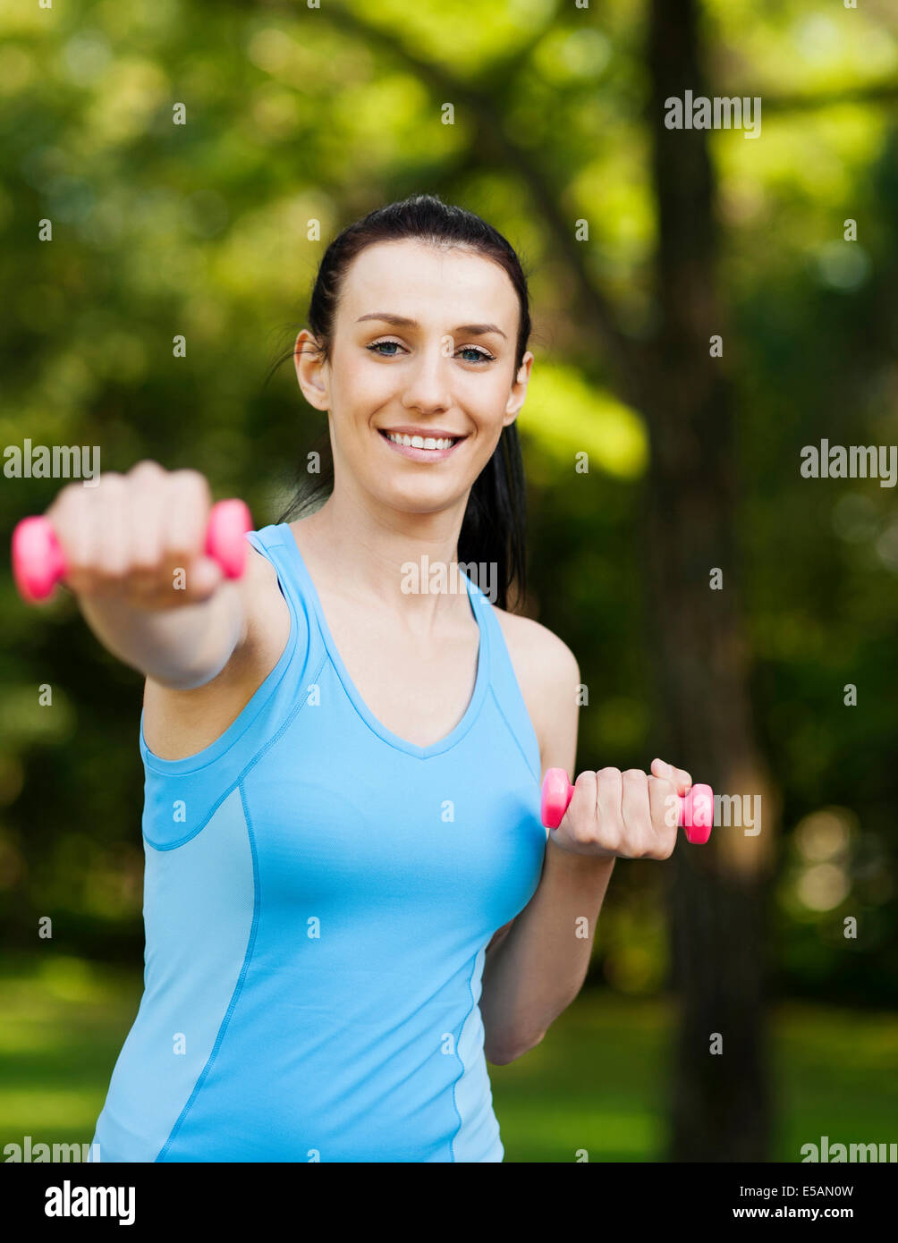 Young woman with dumbbells, Debica, Poland - Stock Image