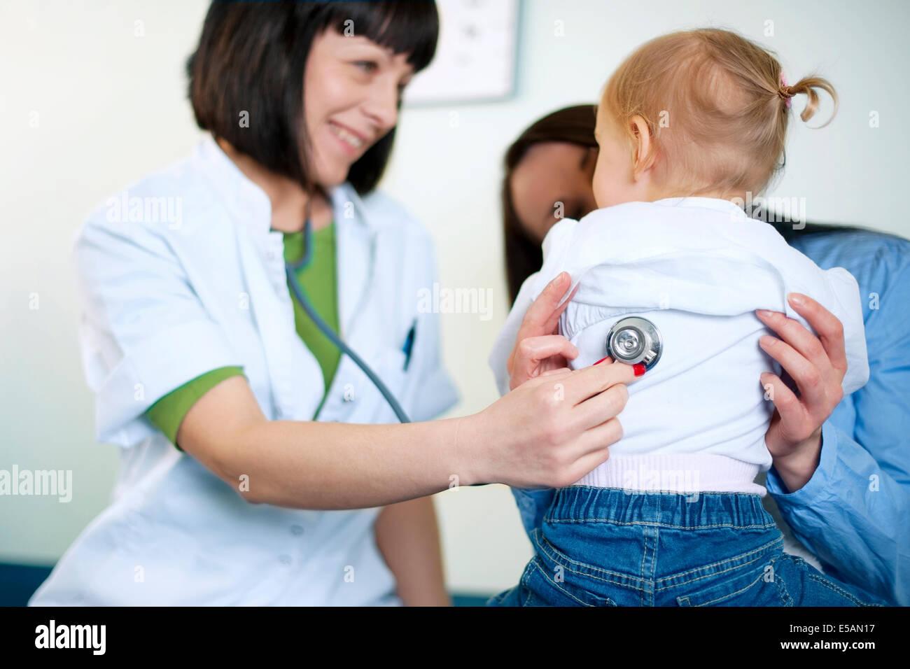 Doctor examining a little girl, Debica, Poland Stock Photo