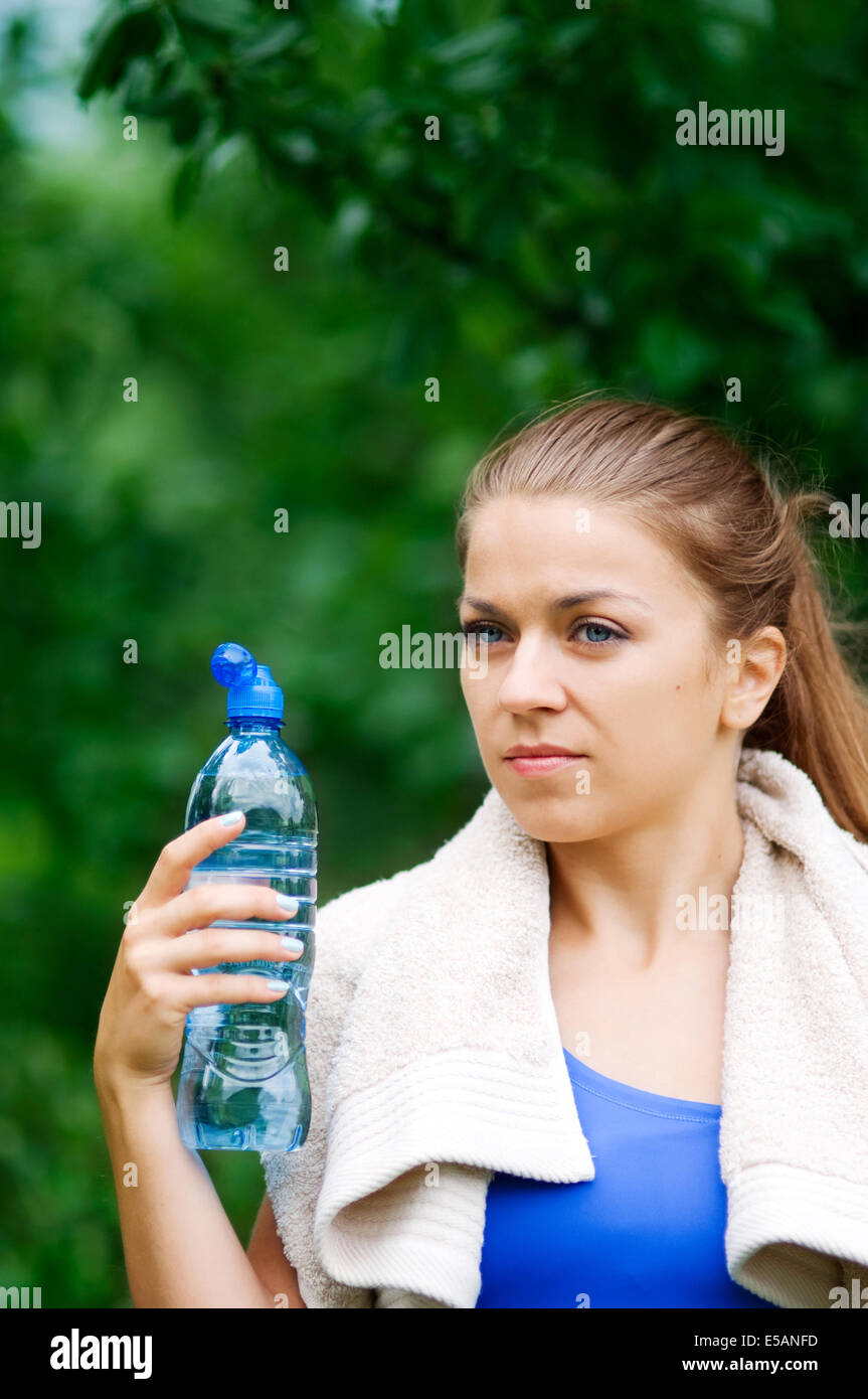 Young woman holding water bottle Debica, Poland - Stock Image
