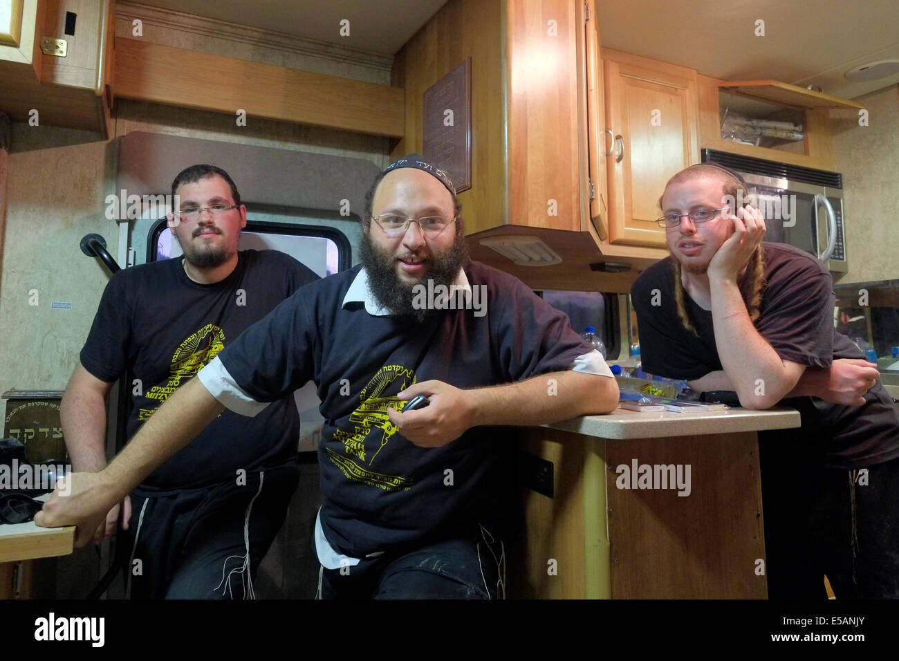 Members of Habad  religious movement in 'Mitzva Tank' van Israel - Stock Image