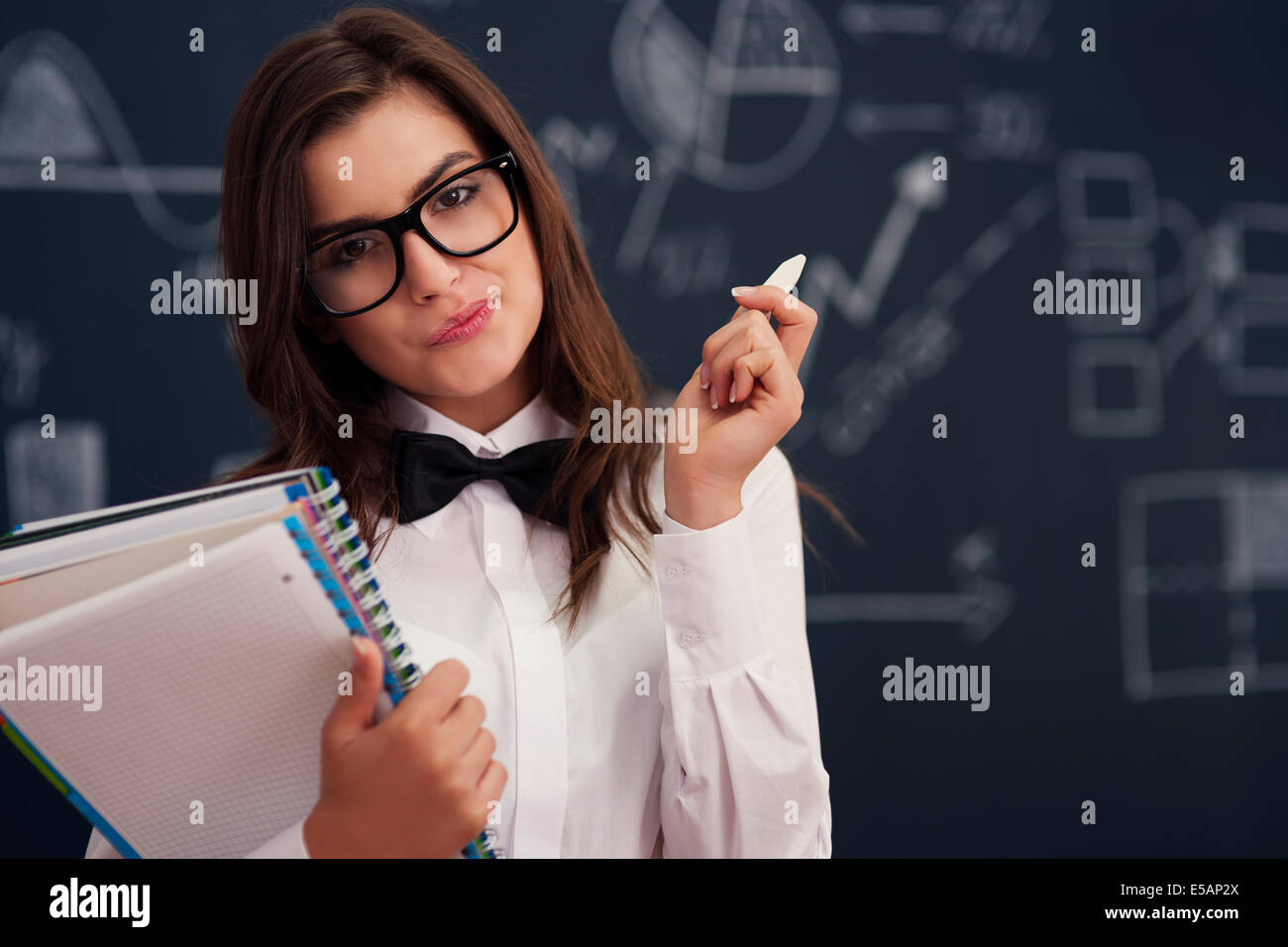 Woman with notebooks and chalk, Debica, Poland - Stock Image
