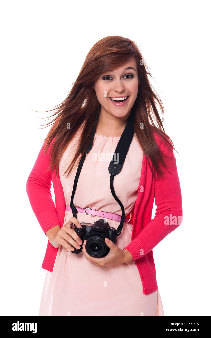 Attractive young woman holding digital camera, Debica, Poland - Stock Image