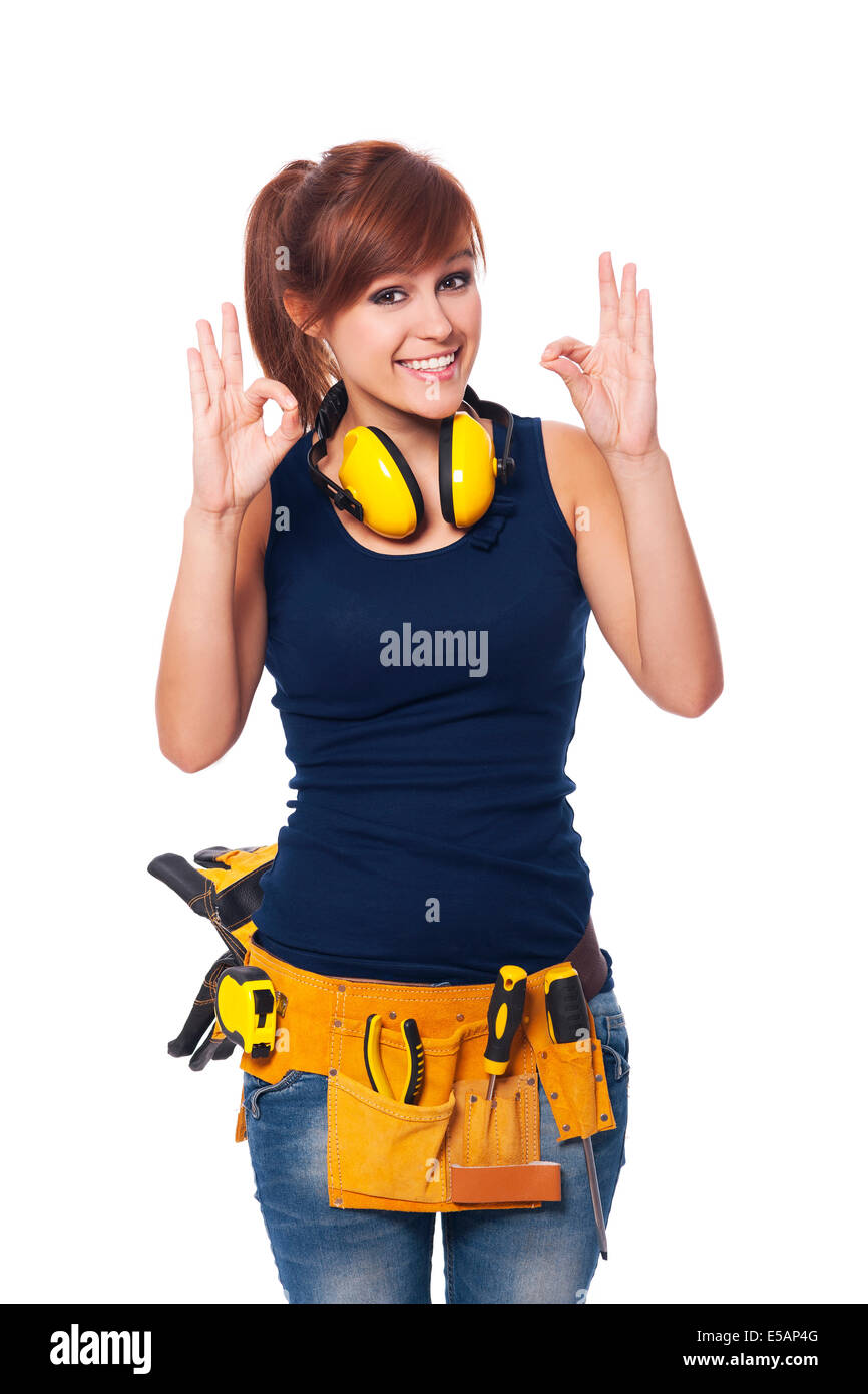 Happy young female construction worker gesturing OK sign Debica, Poland - Stock Image